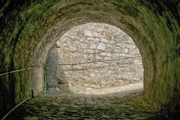Arch in medieval fortress stone wall at Corfu , Greece.