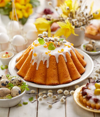Yeast cake with icing and candied orange peel, delicious Easter dessert, traditional Easter pastries in Poland