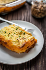 Shepherd's pie on a wooden background