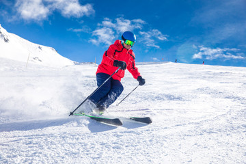 Fototapete - Man skiing on the prepared slope with fresh new powder snow in Tyrolian Alps, Zillertal, Austria