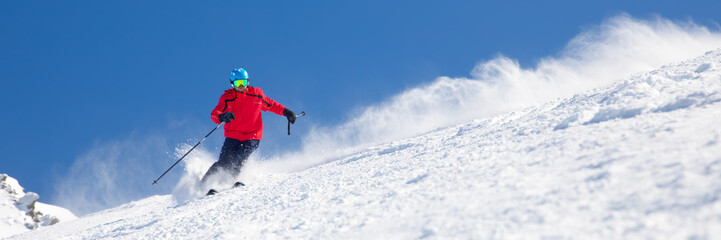 Printed kitchen splashbacks Winter sports Man skiing on the prepared slope with fresh new powder snow.
