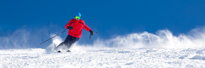 Aluminium Prints Winter sports Man skiing on the prepared slope with fresh new powder snow in Tyrolian Alps, Zillertal, Austria