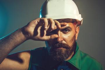 Hard work. Builder working with construction helmet. Portrait architect builder on construction site.