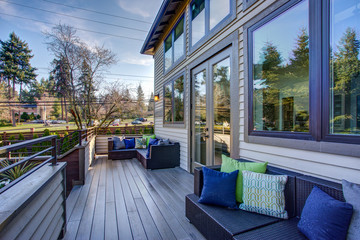 New construction home exterior boasts luxury deck