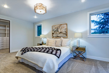 New luxury custom built home with white master bedroom.