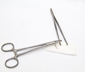 Medical equipment : a surgery needle (straight 1/2 circle), Chirurgis tweezers, needle holder and bandage