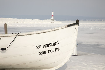 Wooden boat, Petoskey Pierhead Lighthouse, Petoskey, Michigan in winter