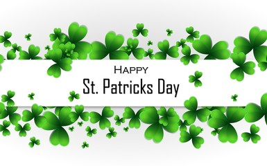 Happy Saint Patrick's Day background. Green shamrock leaves and white paper banner