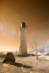 Manning Memorial Lighthouse on sandy Lake Michigan beach  in infrared