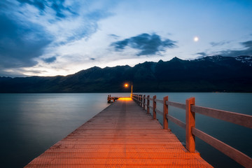 After sunset, the moon is rising at Glenorchy Wharf, New Zealand, South Island.