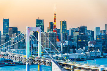 Wall Mural - Asia Business concept for real estate and corporate construction - panoramic modern city skyline bird eye aerial view of Odaiba, tokyo tower & rainbow bridge under golden sun in Tokyo, Japan
