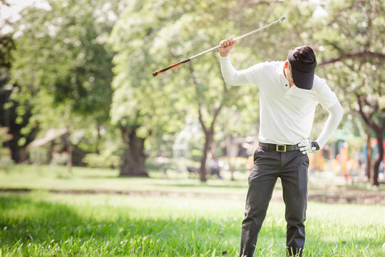 Asian men angry golfer trying to break his club