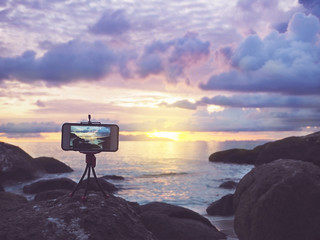 smartphone on stand mobile tripod take sunset landscape photo and video timelaps