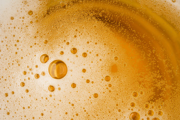 Close up Bubble froth foam of beer in glass or mug for background on top view photo frome dslr full frame hi resolution