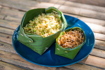 Thai Southern spicy rice salad with fried crispy anchovy