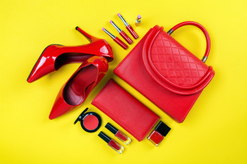 Overhead view of essential beauty items, Top view of red leather bag, red shoes and cosmetic