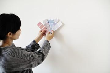 Asian woman choosing wall color