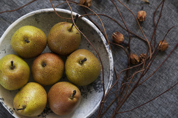 ripe pears in a gray bowl
