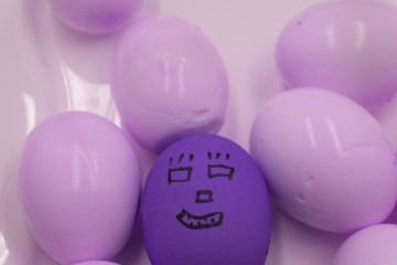 funny Easter eggs painted with a person lying in the nest .