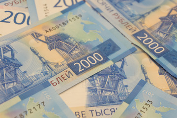new Russian banknotes denominated in 2000 rubles in the male hand close-up, top view .