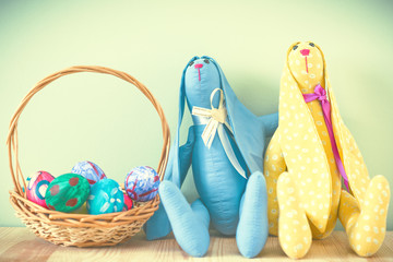 Easter bunnies on a green background