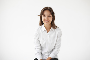 Positive human facial expressions, emotions, feelings, reaction and attitude. Isolated studio shot of beautiful optimistic young Hispanic woman smiling broadly, enjoying good day or positive news