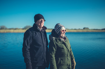 Senior couple by the water in winter