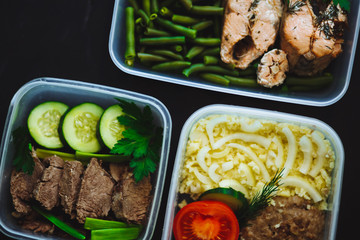 Close up of meat and vegetables in containers on black background, snack, dinner, lunch.