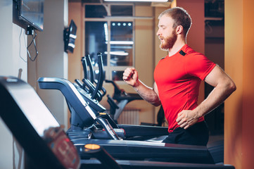 the athlete runs on a treadmill in the gym