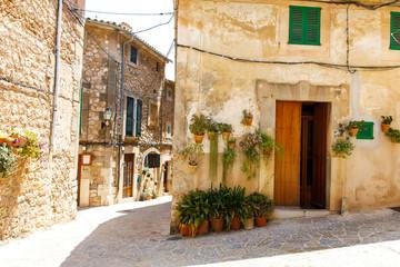 Beautiful street in Valldemossa with traditional flower decoration, famous old mediterranean village of Majorca. Balearic island Mallorca, Spain