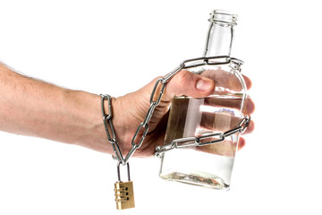 a bottle of alcohol in hand with chain and lock. the concept of alcohol dependence