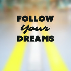 Follow Your Dreams - Inspirational Quote, Slogan, Saying - Success Concept Illustration with Label and Blurry Highway Image Background