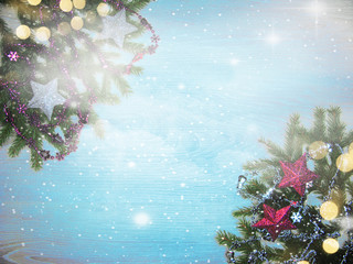 christmas decoration and garland lights on vintage wooden background