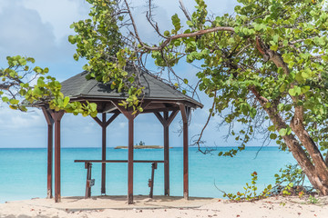 Guadeloupe, beautiful pink sand beach in Marie-Galante island, wooden shelter on the beach