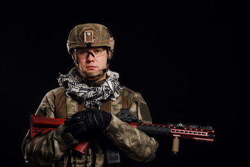Photo of soldier in helmet with gun