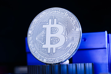 Image of crypto currency, bitcoin and processor on blue background