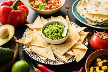 Mexican food Guacamole Nachos Tortilla chips salsa and beans