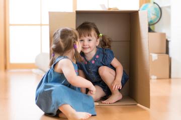 Children little girls playing inside box