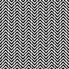 Simple seamless abstract pattern. Black and white print. Strips in the form of a zigzag.