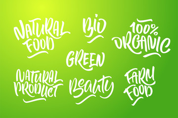 Lettering set for natural products in green colors. Handwritten logo Natural food, 100% organic, farm food, Bio, natural product, green, Beauty.