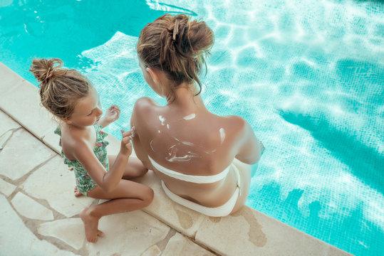 girl with mother sunbathing