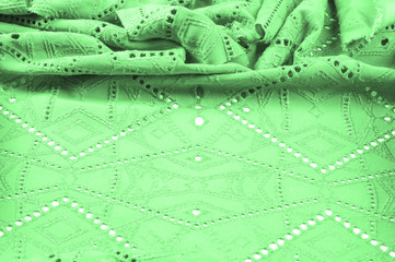 texture, pattern. Cloth green dense with perforated holes. Perforated to perfection, which is twice as much fun!