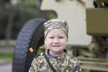 Little boy in military uniform