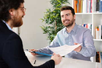 Businesspeople very happy after successful negotiation