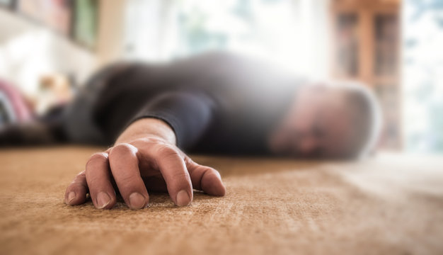 a man lies unconscious in his apartment