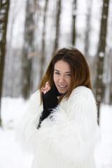 beautiful young woman enjoying winter in the woods