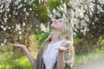 Beautiful young teen girl outdoors enjoy nature in springtime