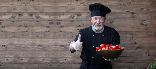 Chef old in uniform with vegetables