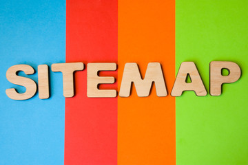 Word Sitemap of large wooden letters on colored background of 4 colors: blue, orange, red and green. Concept sitemap as list of pages to website in XML format for internet search engines spiders