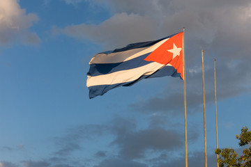Cuban flag. National symbol intensely waving in a dramatic sky.